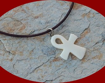 Pretty Petit Ivory Colored Bone Ank Pendant on Saddle Brown Leather Cord