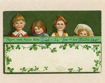 Vintage St Patrick's Day Postcard Ellen Clapsaddle Four Children Looking from Behind Wall Green Shamrocks IAPC Embossed Used - 9849P