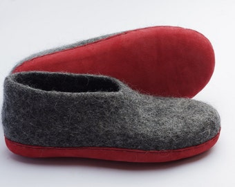 Felt wool slippers with sole for women or man made from natural dark gray sheep wool
