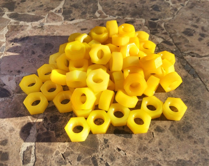 Yellow colored nylon hex nut 5/16-18
