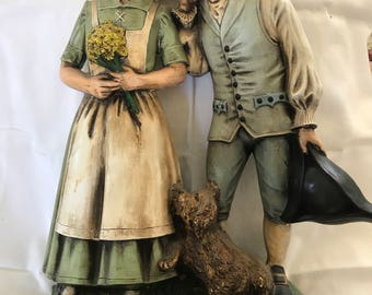 Young ColonistCouple & Dog Ceramic Statue