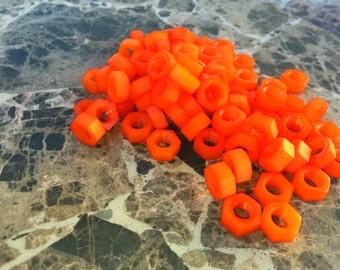 Orange colored nylon hex nut 5/16-18