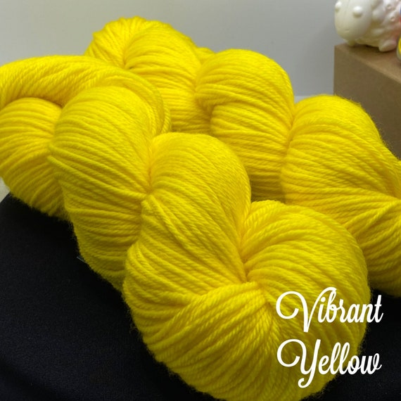 Hand Dyed Yarn, Pantone Inspired Formulary color: VIBRANT YELLOW, DK weight, ready to ship, can be dyed to order on other bases.