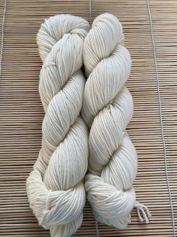 Yarn, Bare/Natural, DK weight, Cashmere MCN, 4 ply, 80 SW Merino/10 Cashmere/10 Nylon, 231 yds/100g skein.