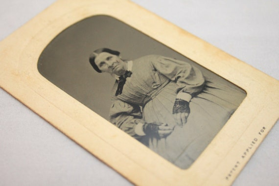 "Civil War Era Tintype of Woman with Original Embossed Paper Holder, Stamped ""Patten Applied For"" 1861-1865"