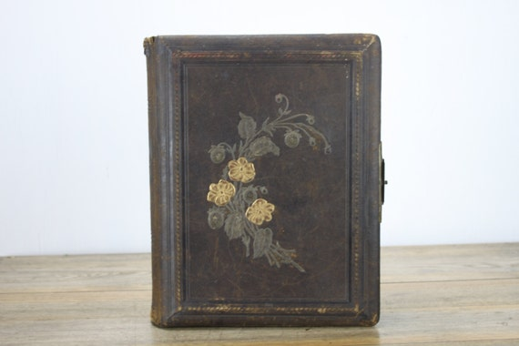 Antique 19th Century Photo Album - 63 Images - 12 Decorated Pages - Leather Bound - Tooled Flower w/ Gilt Accents - Silver Plated Clasp