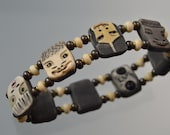 Bracelet Baby Faces Hand Sculpted of porcelain on stretchy elastic