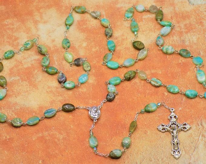 Blue Opal Rosary - Semi Precious Blue Opal Hand-Cut 7-11mm Flat Oval Beads - Italian Rose and Mary Center -  Italian Silver Hearts Crucifix