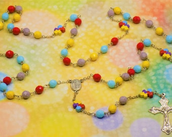 Puzzle Piece Rosary - Czech Opaque Red, Blue, Yellow and Purple Beads - Ceramic Puzzle Piece Beads - Fatima Center - Grapes & Vines Crucifix