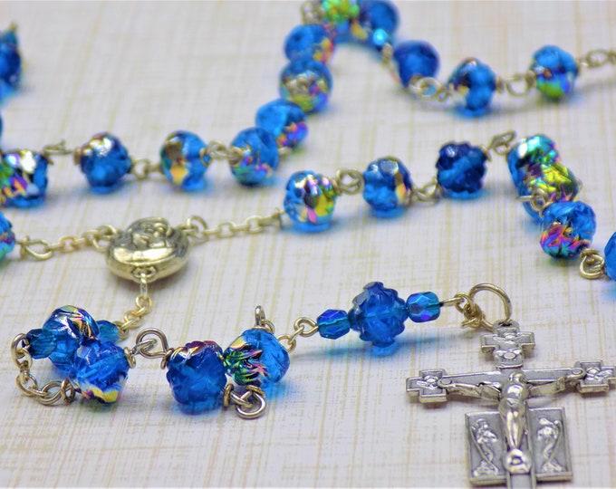 Czech Capri Blue Rosebud Rosary - Czech Capri Blue Virail Crystal Rosebud Beads - Center with Earth from Jerusalem - Italian Angels Crucifix