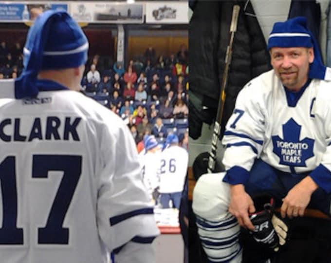 Royal blue hockey hat; Stickheads hockey stick hat