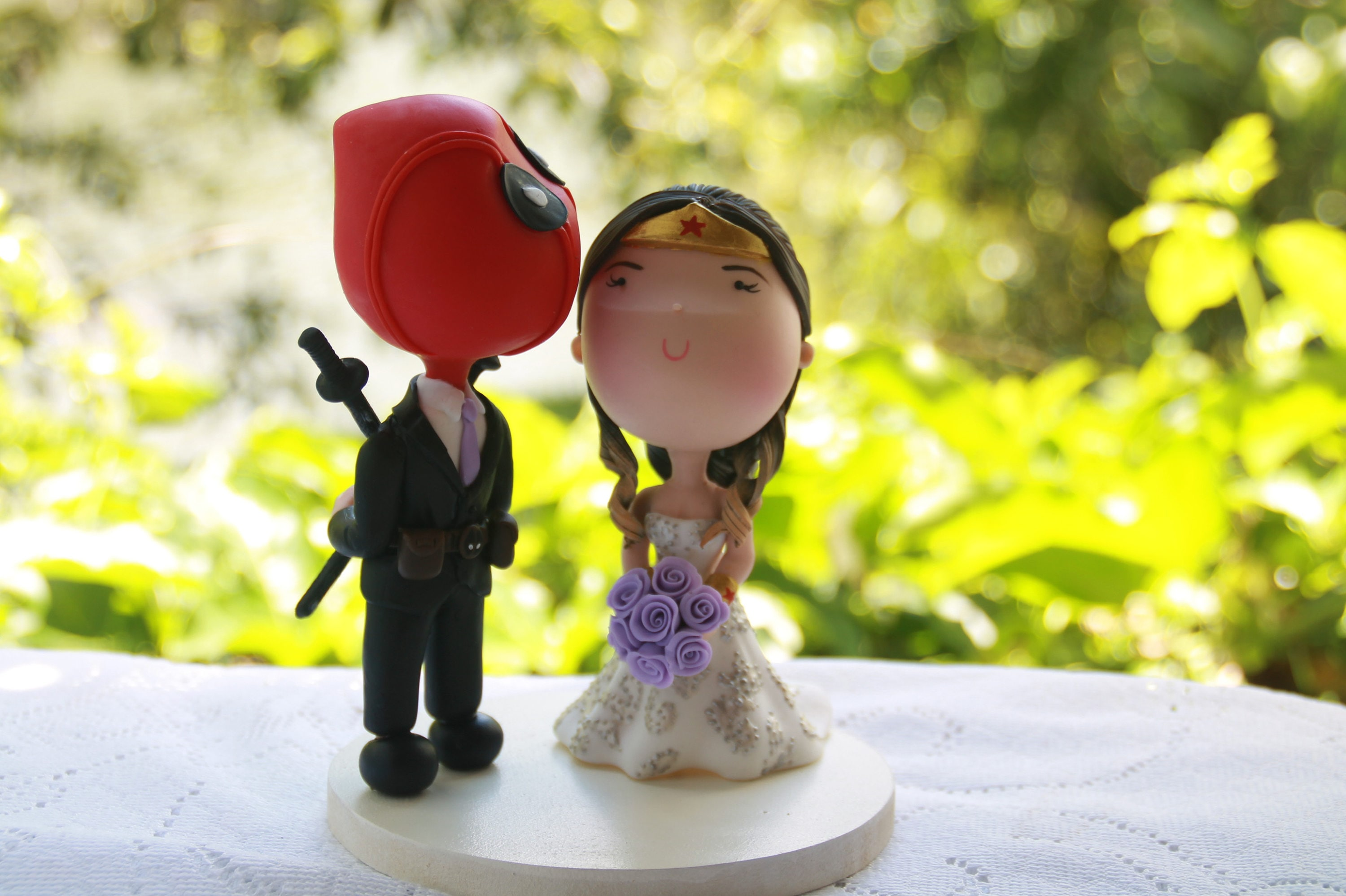 Deadpool Groom and Wonder Woman Bride. Wedding cake topper.
