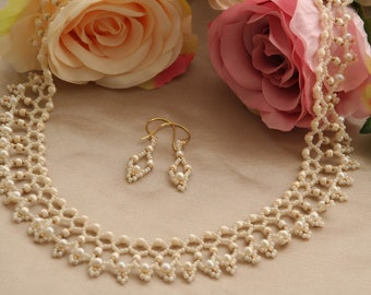 Cream netted necklace and earrings with gold highlights