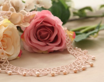 Peach pearl netted necklace and earrings