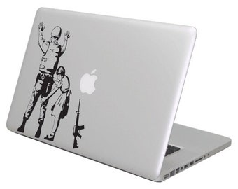 Security check/soldier Banksy MacBook decal sticker, fits all sizes.