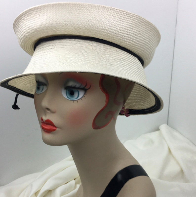 Tea Party Hats – Victorian to 1950s Parasisal Straw Travel Hat Creamy White Black Trim Woman Folds Flat One Size Adjustable $98.00 AT vintagedancer.com