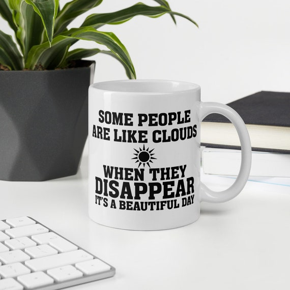 Some people are like clouds funny saying coffee mug makes a great Christmas or holiday gift
