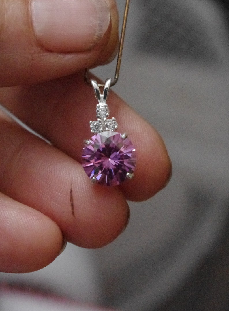 Lovely Pink Moissanite with Natural white zircon accents in Sterling Silver Pendant
