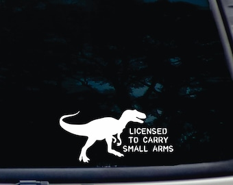 bcee1895e T-rex - licensed to carry small arms! funny die cut vinyl decal [a-1909]