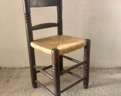 Primitive Spanish Rush Seat Chair, Carved Wood, with Straw Seat of the 20th Century, wooden wicker chairs