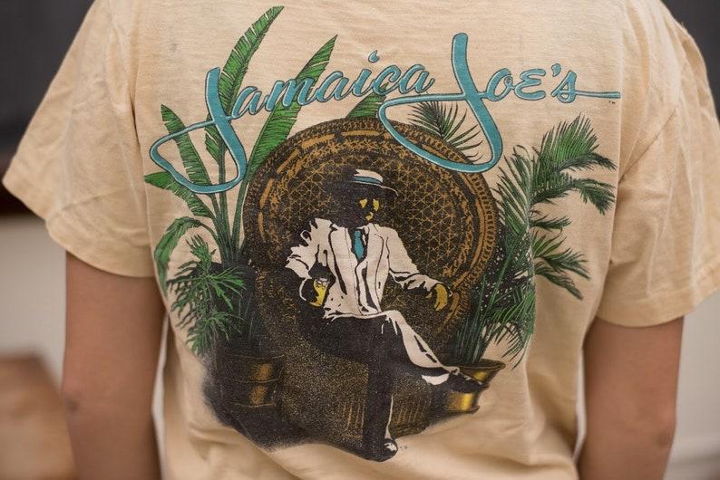 8b7c0c8b133 Vintage Pale Yellow Jamaica Joes Tourist T-Shirt | Etsy