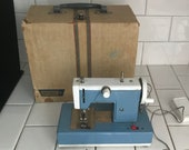 Child size BROTHER sewing machine Blue white metal original 1930 39 s hand crank or battery operated In Original Case collectible display
