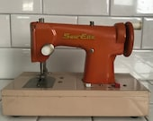 Child size SewEtte Orange and beige sewing machine hand crank Battery operated Japan Metal 1940 39 s collectible display all metal