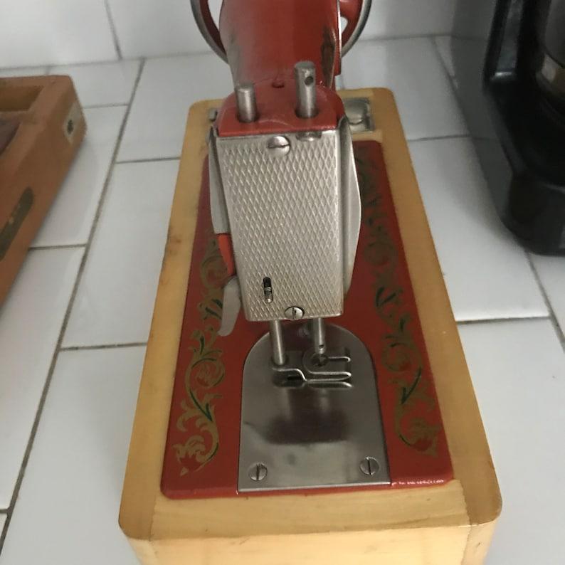 Child size USSR sewing machine Dark Orange Lots of Gold scroll work All metal original 1930/'s hand crank