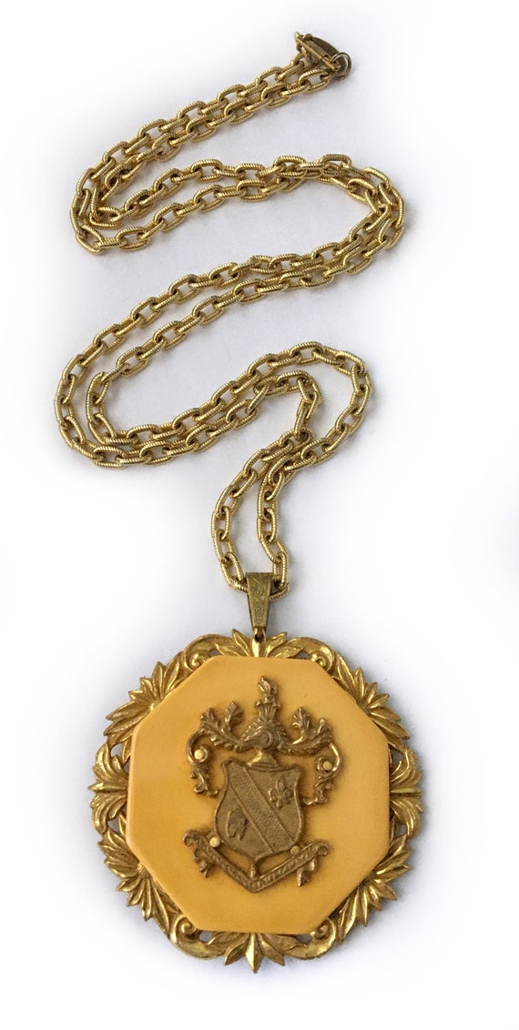 Haskell Rare Bakelite and Gilt Coat-of-Arms Herald