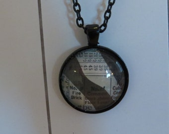 Recycled Newspaper pendant necklace One of a Kind