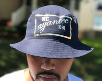 NCAT Bucket Hat. NC Ayantee 1891 Hats. Blue and Gold. Khaki and Gold. Aggie Pride. GHOE Hat