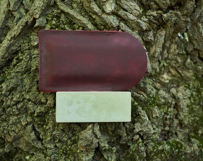 Vintage pocket sharpening stone in red pouch