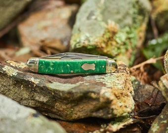 Vintage Seneca Cutlery pocket knife with rare green scales