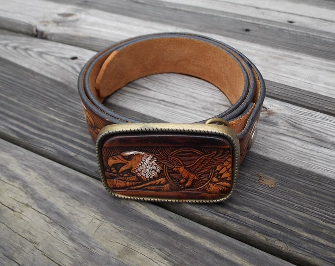 Leather belt with embossed eagles and leather and brass belt buckle with embossed eagles