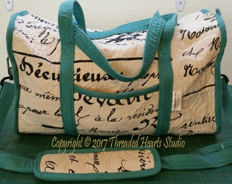 Turquoise, Cream and Black Travel Bag