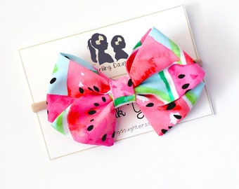 Watermelon seed Liverpool fabric hair bow on a nylon headband for little girls