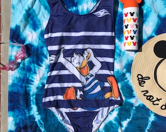 0566eac22a Aquaduck swimsuit inspired by Donald Duck and his wild and crazy slide on  the Disney Fantasy and Disney Dream!