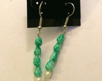 Green and white stacked dangle earrings