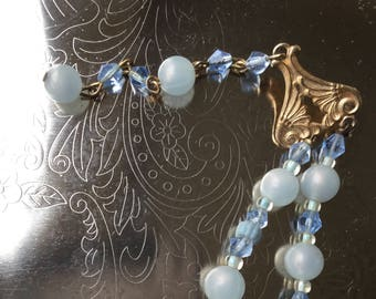 A Vintage Handmade blue and white beaded necklace