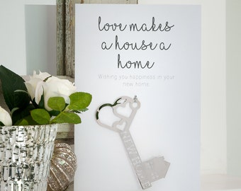 First Home card, Love makes a house a home card,, Housewarming card with a silver key, Gift card for a new home with a metallic key