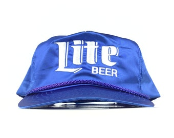 32bf31976571b Vintage 90s Lite Beer (Miller Brewing Co.) Embroidered Blue Satin Baseball  Cap Hat SnapBack Men s Size