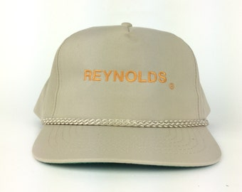 aec801923a3 Vintage REYNOLDS Embroidered Logo Baseball Cap Hat Snapback Fits Most Tan  Color