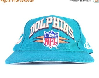 7ed4d4328 On Sale Now Vintage 90s NFL Miami Dolphins Logo Athletic Diamond Teal  Baseball Cap Hat Snapback Adult Size