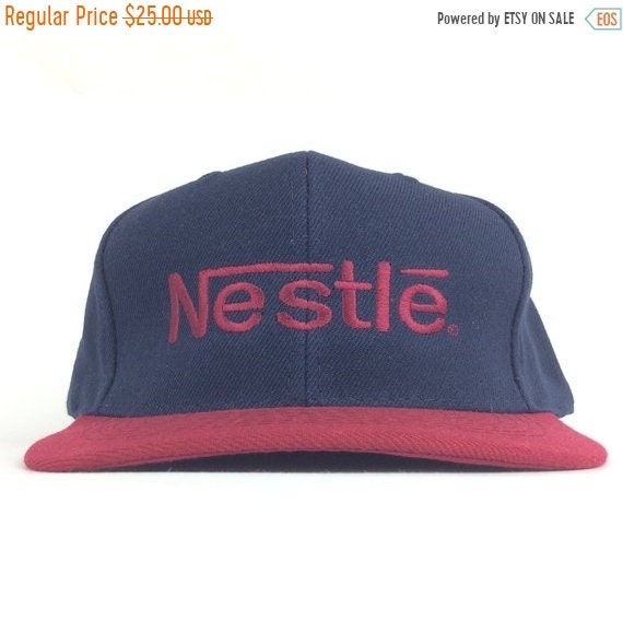 ddb05082153 On Sale Now Nestle Embroidered Logo Baseball Cap Hat Snapback