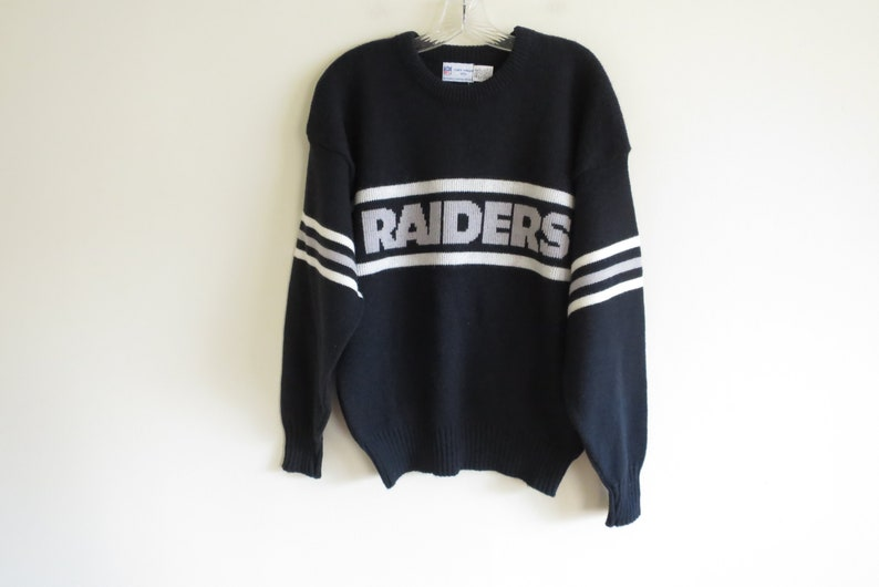 Large | Made in USA fit Vintage 80/'s Los Angeles Raiders Cliff Engle wool blend sweater tag size Medium-Large DEADSTOCK