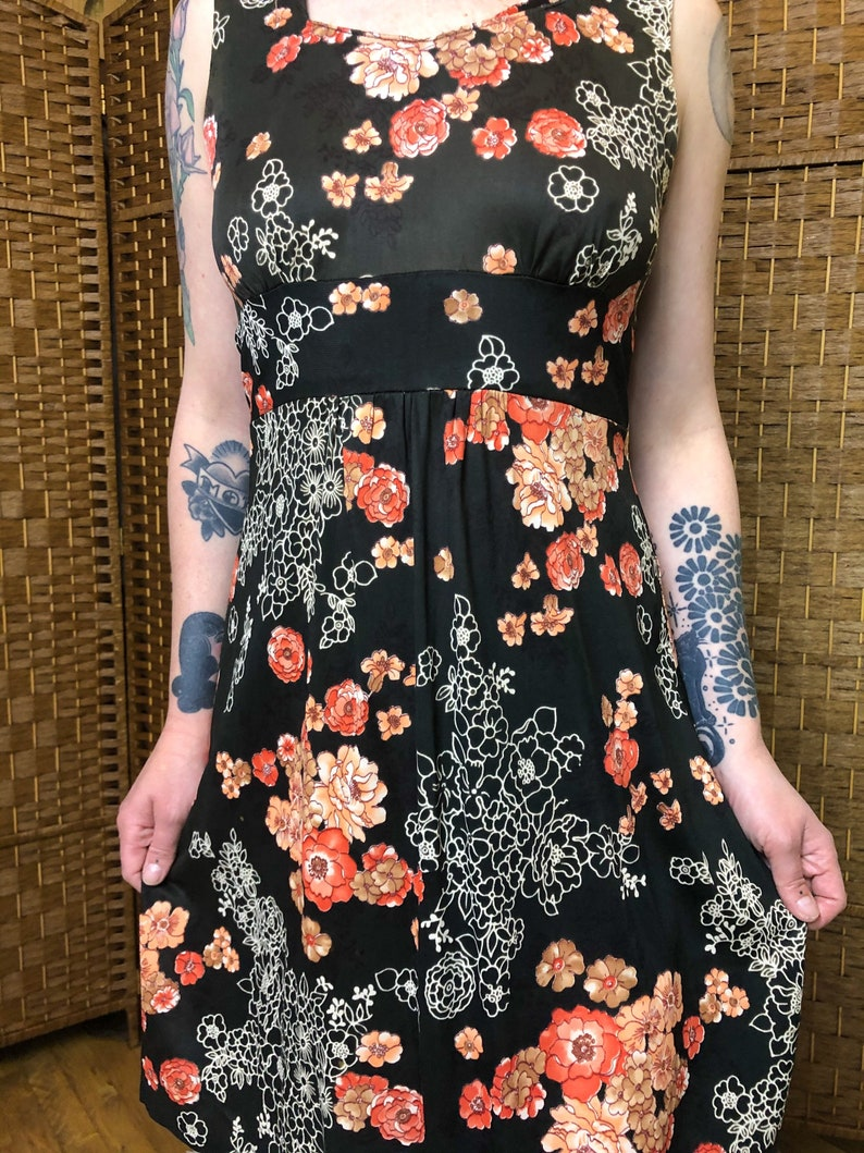 Small 1970s Floral Black Dress