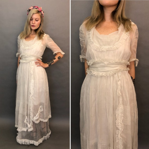 Small antique organdy gown with ruffles and layers