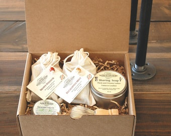 Shaving gift box, 2 Bars cold process soap , Shaving soap, shaving brush, and a healing salve just in case.  A great gift.