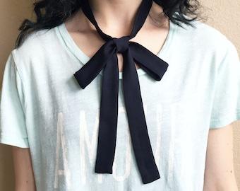 "Black bow tie. 53""x1"" black silk skinny tie. Ladies thin neck tie can be worn as a choker, hair tie or sash. 2 layers of pure silk."