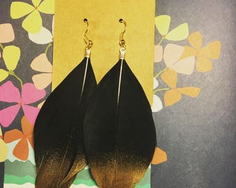 Black feather gold dipped statement earrings